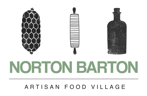 The logo for norton barton artisan food village